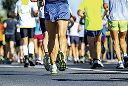 Runners legs in a road race