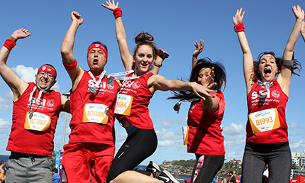 SSI's City2Surf team jumping in celebration after the race in 2016.