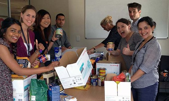 SSI staff packing food hampers with donations from SCEGGS.