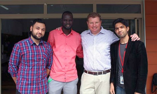 Youth Collective coordinator Dor Akech Achiek (centre left), with Federal Member for Reid Craig Laundy (centre right).
