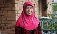 A smiling mother who is seeking asylum in Australia