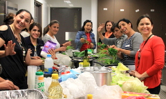 Women prepare Iraqi meal for Shared Table Project.