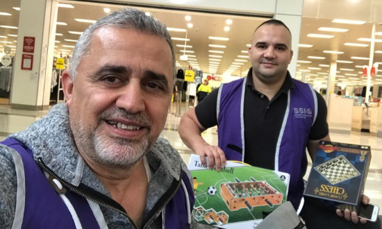 Emad and Adam buying board games for newly arrived refugees stuck at home