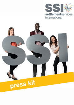 SSI Annual Report 2016 to 2017 Front Cover depicts happy employees holding large SSi letters
