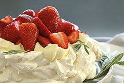 a cream cake with strawberry topping