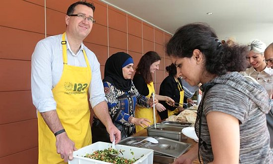 SSI Manager of Humanitarian Services David Keegan serving lunch at Community Kitchen.
