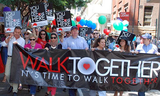 Politicians from Liberal, Labor and Greens walked together.