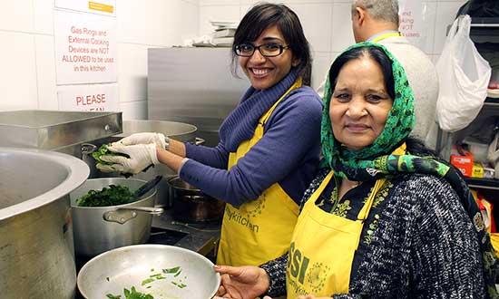 Sameera and her mother at Community Kitchen.