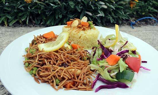 Vegetarian biryani, with noddles and salad.