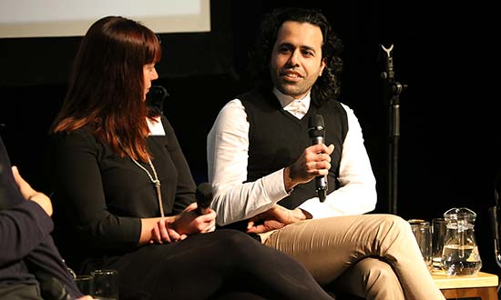 Katy Green and Ali Mousawi on stage for a panel discussion.