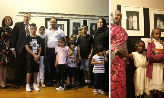 Some of the featured refugee families at the Courageous Journeys book launch.