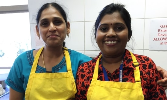 Settlement Services International staff members cook curries from Sri Lanka and India