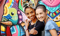 Courtesy The Australian: Ethiopian refugee Adi Tefera, left, with volunteer chef Kate Spina at Four Brave Women