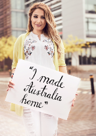 Ania Kebabjian holding an 'I Made Australia Home' sign