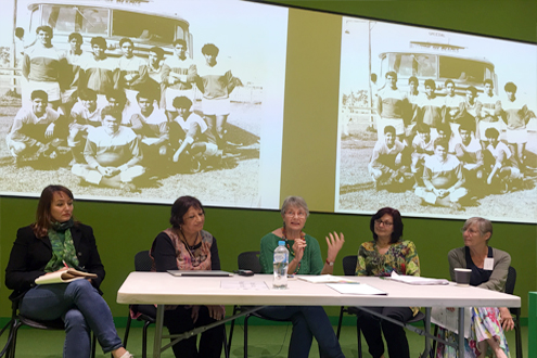 "Andrew Jakubowicz's colleagues at Festschrift Friday December 8, 2017.  From Left: Assoc Prof Heidi Norman,  Assoc Prof Devleena Ghosh, Prof Heather Goodall, Assoc Prof Nina Burridge , Prof Hilary Yerbury.  Image on screen ""Redfern All Blacks football team at  Casino  "" (Andrew Jakubowicz, photographer, 1969)."