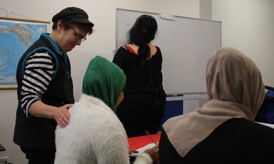 A volunteer teaches a class of women seeking asylum in Australia.