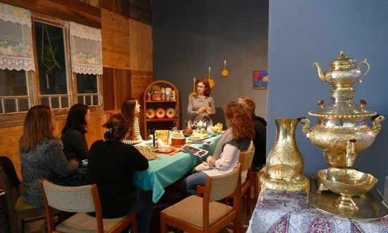 A Persian tea ceremony takes place in a kitchen-themed art intsallation.