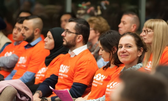 SSI staff members sit in the audience at a Sydney Alliance assembly.