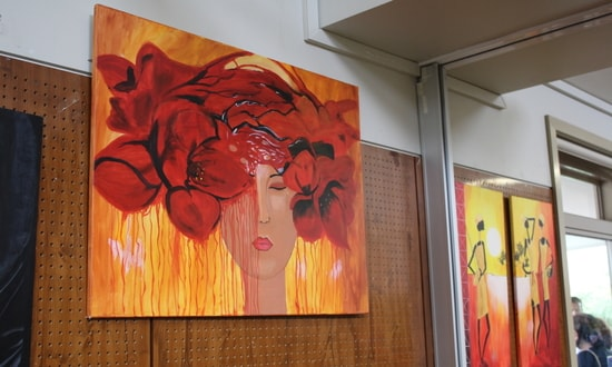 A picture of Iman's artwork showing a woman with a red crown of flowers