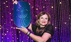 SSI CEO named 2017 Telstra Australian Business Woman of the Year holding her award